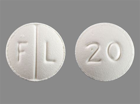 F L 20 Pill Images (White / Round)